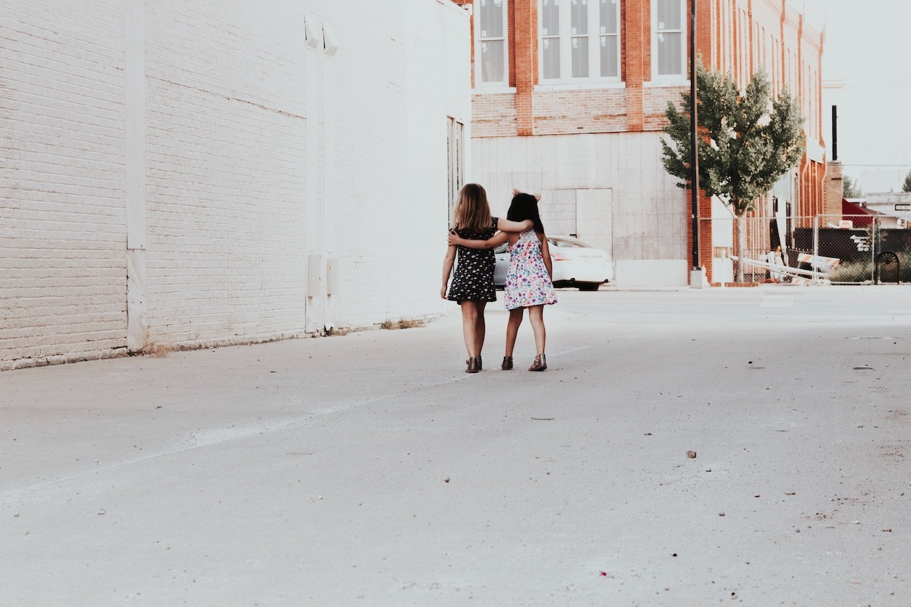 children-arms-two-girls-andrea-tummons-unsplash copy